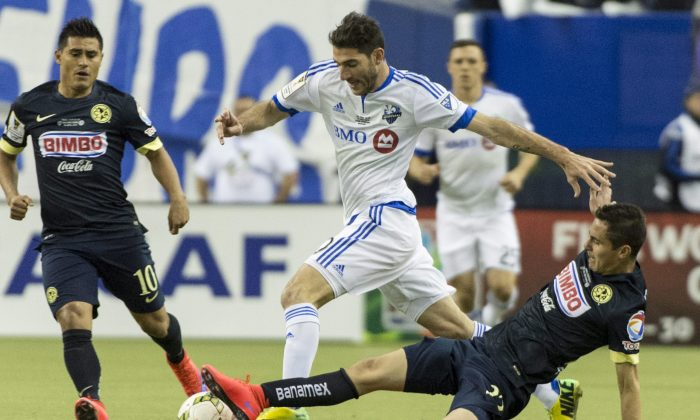 Montreal Impact midfielder Ignacio Piatti knocks the ball away from Club América defender Paul Aguilar at Stade Olympique in Montreal. Club América won CONCACAF Champions League with an outstanding performance on April 29, 2015. (The Canadian Press/Paul Chiasson)