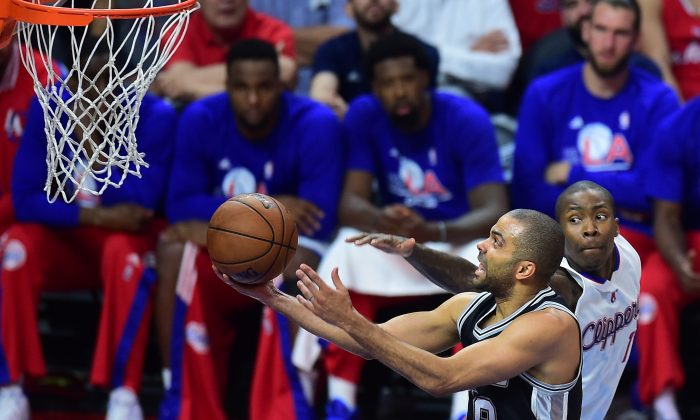 Tony Parker of the San Antonio Spurs shoots under pressure from Jamaal Crawford of the Los Angeles Clippers during Game 5 of their first round NBA playoffs series in Los Angeles. (Frederic J. Brown/AFP/Getty Images)