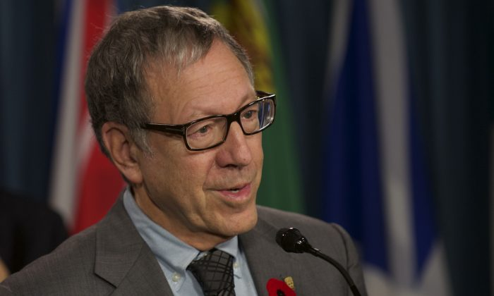 Liberal MP Irwin Cotler speaks during a press conference last November. Cotler introduced a bill on April 27, 2015 to restore hate speech provisions to the Canada Human Rights Act, which were repealed in 2013. (Matthew Little/Epoch Times)
