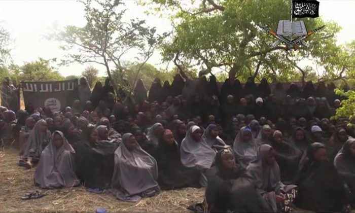 This Monday May 12, 2014 file image taken from video by Nigeria's Boko Haram terrorist network, shows the alleged missing girls abducted from the northeastern town of Chibok. (AP Photo)