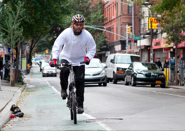 Wylie Dufresne, riding his bike on the Lower East Side, by his restaurant wd-50. (Samira Bouaou/Epoch Times)