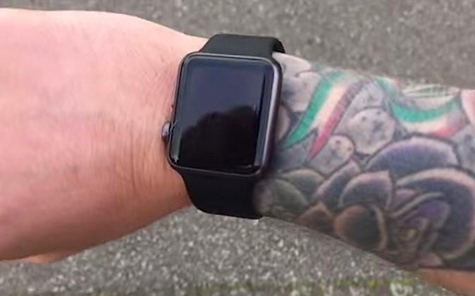 A screenshot of a video posted to YouTube by Michael Lovell showing how he has to frequently re-enter his password when wearing his Apple Watch on his tattooed arm. (Michael Lovell/YouTube)