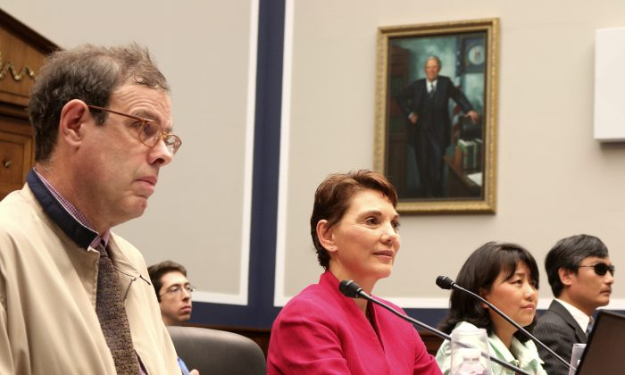 """Nicholas Eberstadt, demographer, American Enterprise Institute; Reggie Littlejohn, founder and president, Women's Rights Without Frontiers; Chai Ling, founder, All Girls Allowed; and Chen Guangcheng, Chinese legal advocate and activist, visiting fellow, Catholic University of America, speak April 30, at a Congressional Executive Commission on China hearing on """"Population Control in China."""" (Gary Feuerberg/Epoch Times)"""