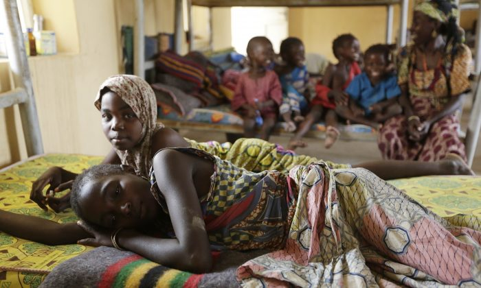 Woman and children rescued by Nigerian soldiers rest at a refugee camp in Yola, Nigeria, on Sunday. (AP Photo/Sunday Alamba)