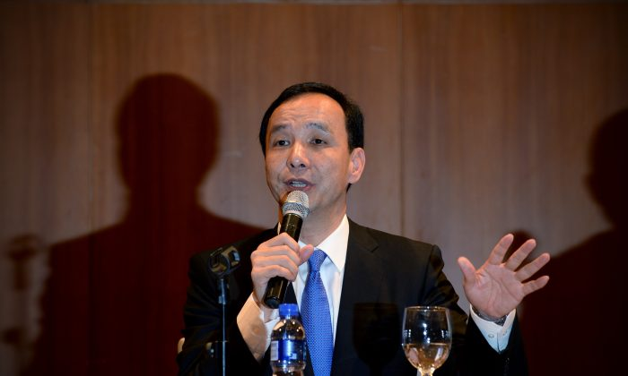"""Eric Chu, chairman of Taiwan's ruling Kuomintang (KMT) party speaks during a press conference at a hotel in Beijing on May 4. The Chinese regime's leaders told Chu that a """"One China"""" policy would be required for any business deals. (WANG ZHAO/AFP/Getty Images)"""