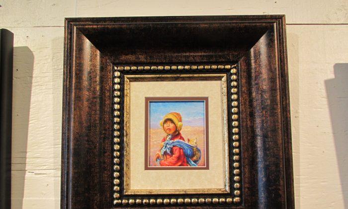 """Guillermo Caraveo """"La nina y el gatito"""" Oil on canvas. (Kati Vereshaka/Epoch Times)"""