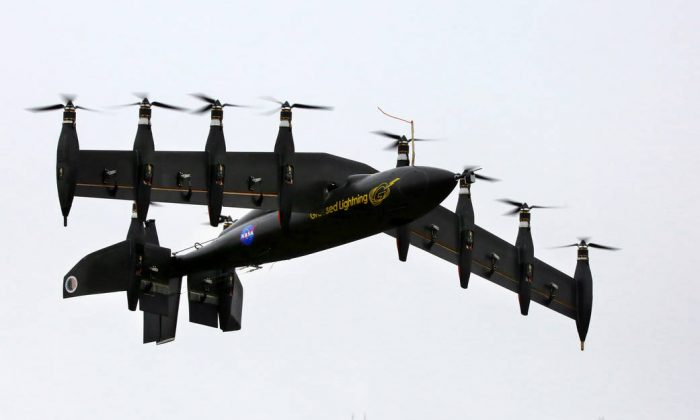 NASA's battery-powered 10-engine plane during at flight test. The electric plane takes off like a helicopter and flies like a plane. (NASA Langley/David C. Bowman)