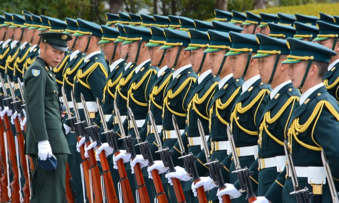 Japan's Self-Defense Force honor guards prepare for a welcoming ceremony of new Defence Minister Gen Nakatani in Tokyo on December 25, 2014.  (Kazuhiro Nogi/AFP/Getty Images)