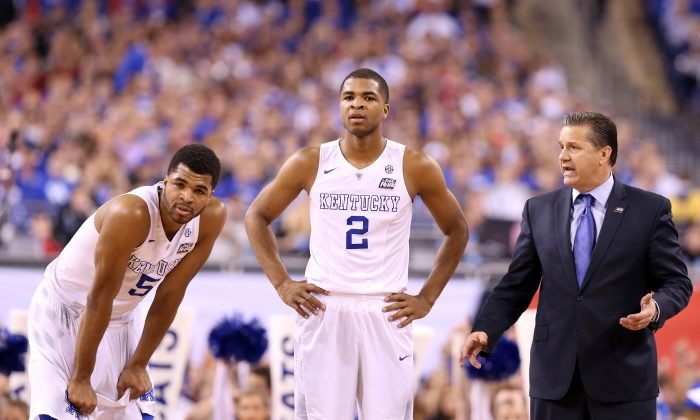 Andrew Harrison (L), Aaron Harrison (C) were two big parts of Kentucky head coach John Calipari's 10-man platoon system that helped the Wildcats all the way to the Final Four. (Streeter Lecka/Getty Images)