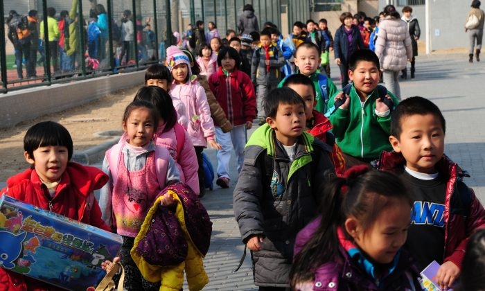 School children leave their elementary school at the end of classes in Beijing on March 13, 2012. (Mark Ralston/AFP/Getty Images)