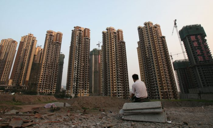 A general view of buildings under construction near the People's Bank of China office building on Sept. 29, 2007 in Chongqing, China. The introduction of real estate investment trusts in China may be an attempt by developers to hold off a market correction. (China Photos/Getty Images)