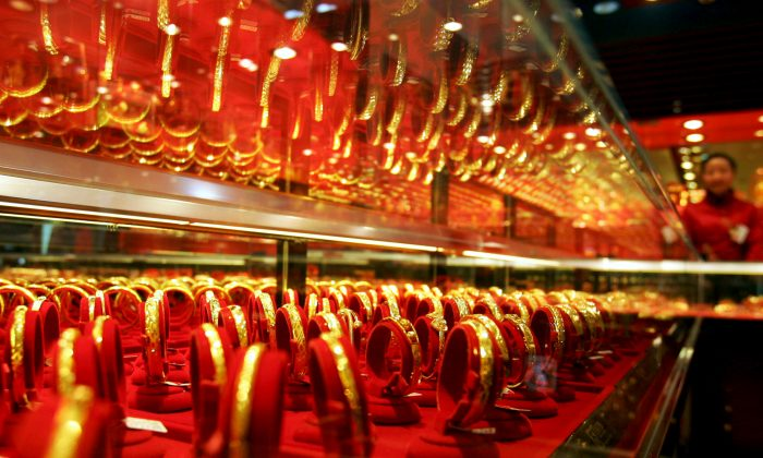 Golden bracelets on display in a jewellery shop in Whuan, China, Jan. 9, 2008. Chinese have always valued gold and now want to take control of the physical price. (China Photos/Getty Images)