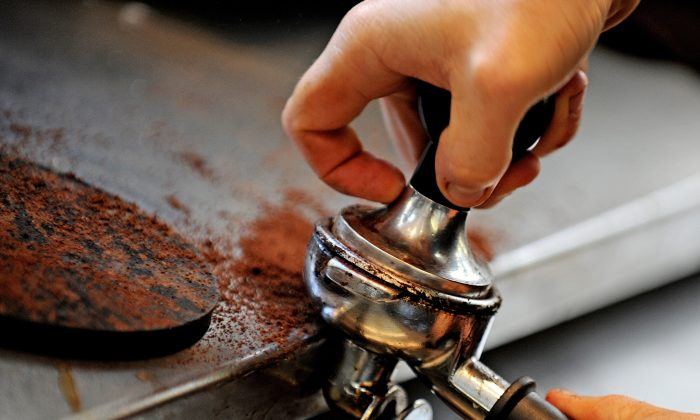 A tamper is used to prepare coffee grounds. (Greg Wood/AFP/Getty Images, file)