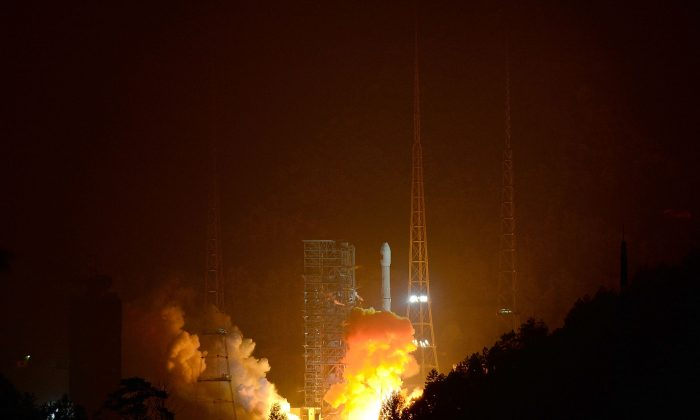 A rocket carrying a lunar probe is launched from Xichang Satellite Launch Center on December 2, 2013, in Xichang, China. The Chinese regime is developing space weapons designed to destroy or disable satellites. (ChinaFotoPress/Getty Images)