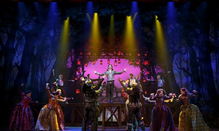 """The Bard (Christian Borle)  revered as something akin to a rock star, is surrounded by his adoring fans (the cast), in """"Something Rotten!."""" (Joan Marcus)"""