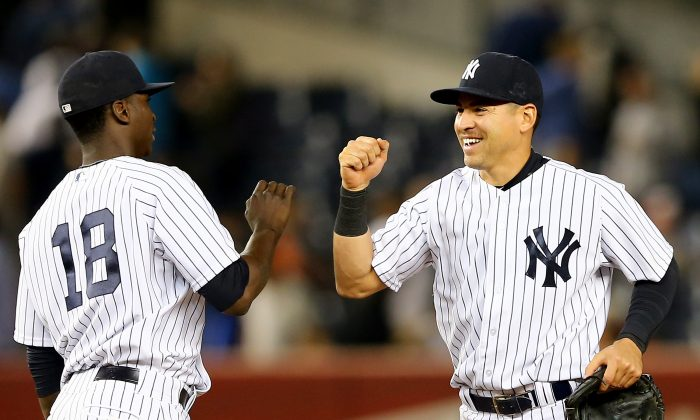 Didi Gregorius (L) and Jacoby Ellsbury have helped the New York Yankees defy the odds and move into first place. (Elsa/Getty Images)