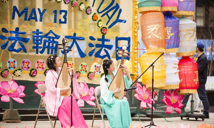 Falun Dafa practitioners perform as part of the World Falun Dafa Day celebrations on Foley Square, Manhattan, on May 13, 2015. (Edward Dai/Epoch Times)
