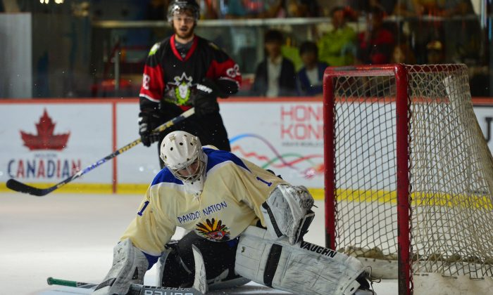 International A winners Pandoo Nation goalie (seen here playing against Gold Club in their Round Robin match on May 8, 2015) put on a super display during the 2015 Ice Hockey 5's tournament at Mega Ice. (Bill Cox/Epoch Times)