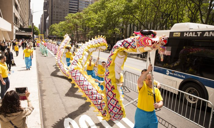 The Falun Gong dragon team performs in the World Falun Dafa Day parade along 42nd Street in New York, on May 15, 2015. (Edward Dai/Epoch Times)