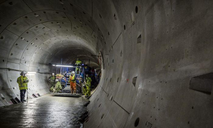 Employees make a flat bottom in the round tunnels of the North/South subway line with a pavermachine in Amsterdam, on February 5,2014. (LEX VAN LIESHOUT/AFP/Getty Images)