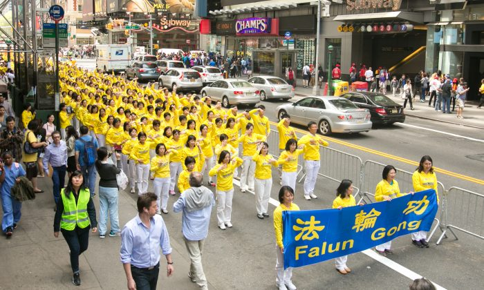 Falun Gong practitioners march in the World Falun Dafa Day parade along 42nd Street in New York, n May 15, 2015, celebrating 23 years since the practice was first spread in public in China in 1992 and also bringing awareness to the persecution that is still happening today in China. (Benjamin Chasteen/Epoch Times)