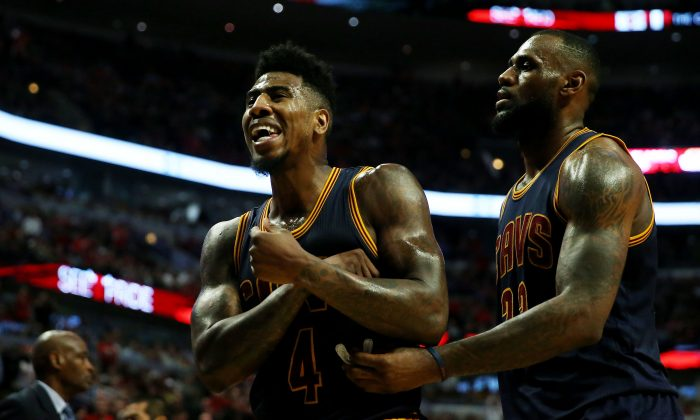 Iman Shumpert (L) and LeBron James have the Cleveland Cavaliers in the conference finals where they'll face the top-seeded Atlanta Hawks. (Jonathan Daniel/Getty Images)