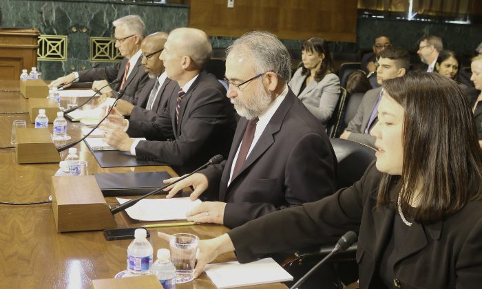 (L to R) Mark S. Cady, Iowa State Supreme Court; David Singleton, Ohio Justice & Policy Center; Neil Fulton, federal public defender; Robert Boruchowitz, Seattle University School of Law; and Erica Hashimoto, Georgia School of Law, testified before the Senate Judiciary Committee, May 13, on the constitutional right to counsel for indigents charged with misdemeanors. (Gary Feuerberg/ Epoch Times)