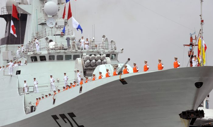 People's Liberation Army Navy sailors stand on the deck of a Chinese missile frigate in Manila on April 13, 2010. The Chinese regime is holding joint naval exercises with Russia in the Mediterranean. (Ted Aljibe/AFP/Getty Images)