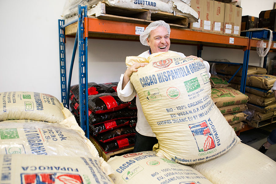 Jacques Torres with a bag of organic cocoa beans. (Samira Bouaou/Epoch Times)