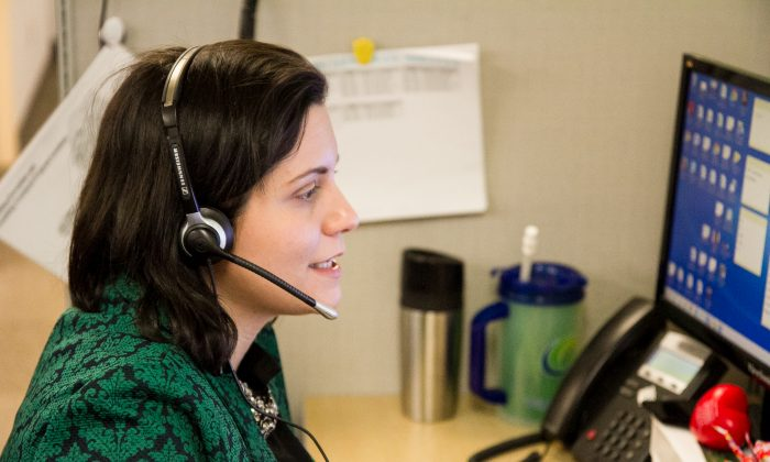 A hotline counselor takes calls in the office of the Mental Health Association of New York City on May 21, 2015.