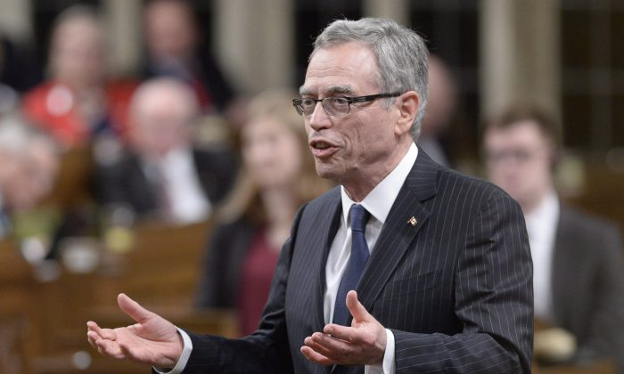 """Finance Minister Joe Oliver speaks in the House of Commons on Parliament Hill in Ottawa, April 30, 2015. He gave the keynote speech on May 19 in Toronto at the PCMA Private Capital Markets Conference and calls crowdfunding the """"new way to raise capital."""" (The Canadian Press/Adrian Wyld)"""