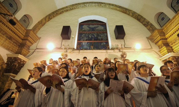 Chinese worshippers sing hymns during the Christmas Eve mass at a Catholic church in Beijing on December 25, 2012. (Wang Zhao/AFP/Getty Images)