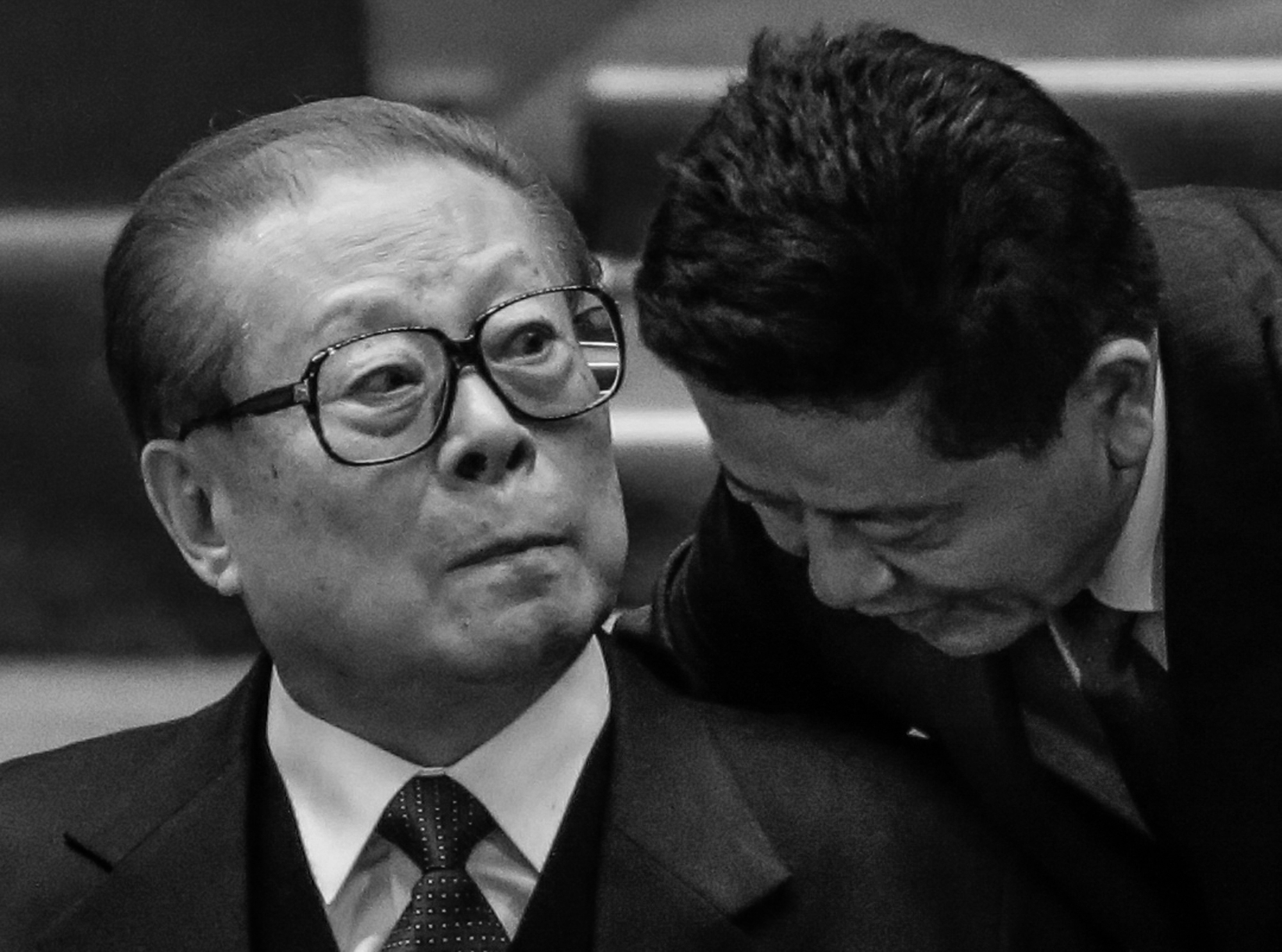 A man speaks to the Former Chinese leader Jiang Zemin, during the closing ceremony for the 18th Communist Party Congress at the Great Hall of the People in Beijing on Nov. 14, 2012. (AP Photo/Lee Jin-man)