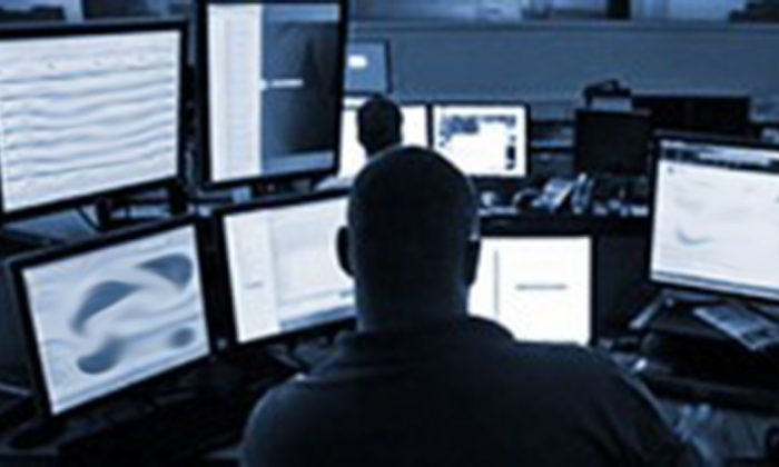 A researcher at security company DBI searches the Darknet. Governments, law enforcement agencies, and private industries are turning to the Darknet to to investigate terrorist organizations, organized crime, and cyberattacks. NOTE: this photo has been modified for security reasons. (DBI)