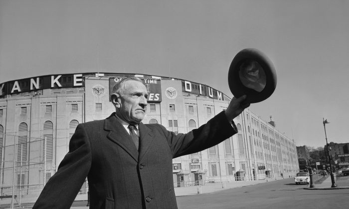 With a wave of his hat, in this Oct. 11, 1957 photo, New York Yankees manager Casey Stengel leaves Yankee Stadium in the hands of the New York Giants football team until next season. The previous day the Yankees had lost Game 7 of the World Series to Lew Burdette and the Milwaukee Braves. (AP Photo)