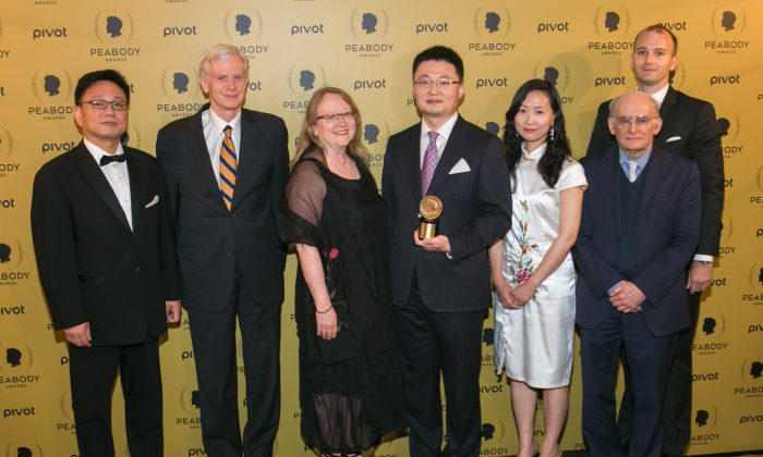 Producer and Director of 'Human Harvest' Leon Lee (fourth from R) holds his award along with his guests during the 74th Annual Peabody Awards Ceremony at Cipriani Wall Street on May 31, 2015 in New York City. (Benjamin Chasteen/Epoch TImes)