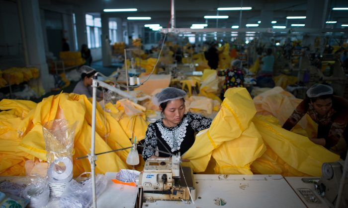 In this file photo, women working is working in Anqiu factory, some 500 kilometers south of Bejing. (Johannes Eisele/AFP/Getty Images)