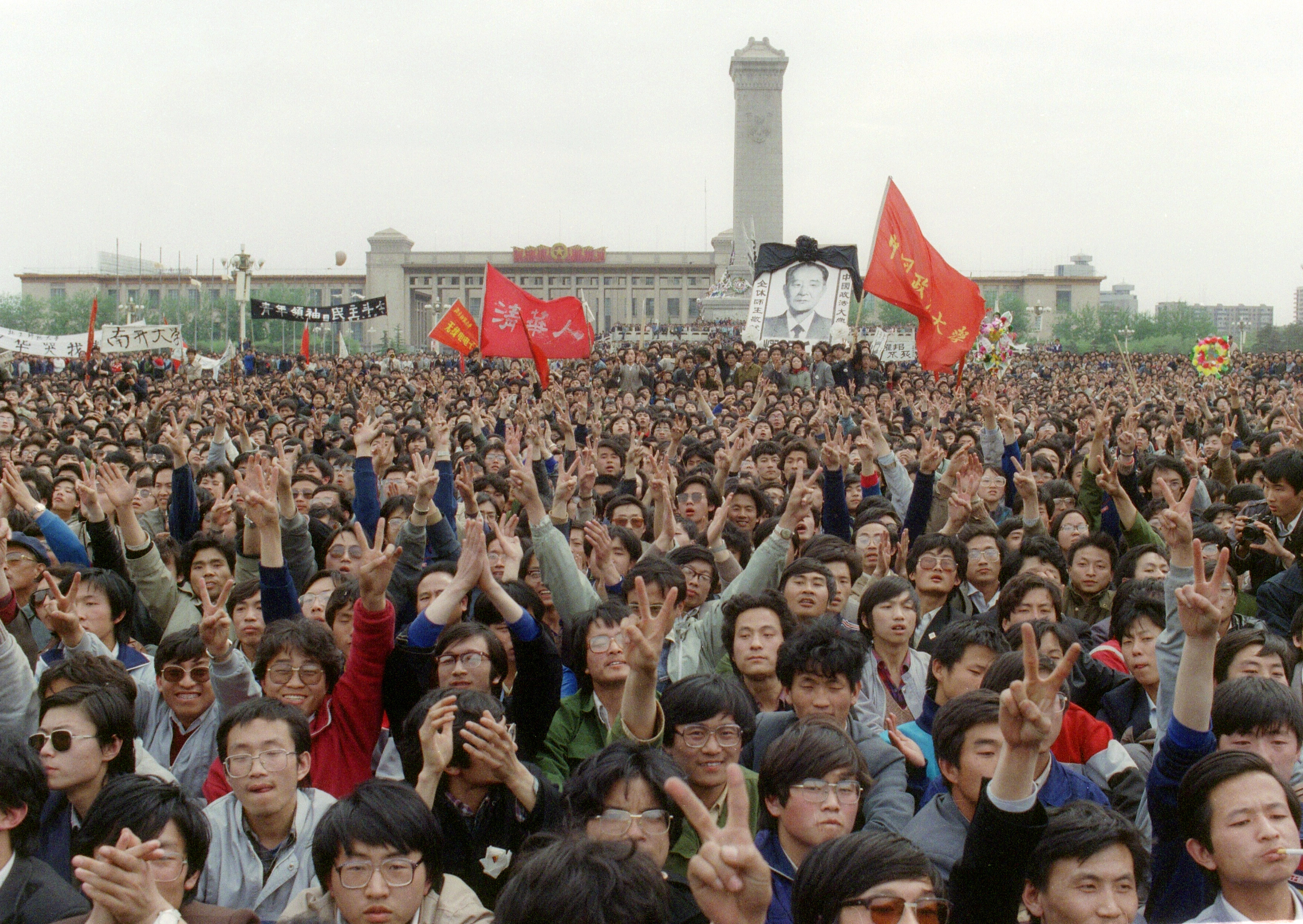 an investigation into the tienanmen square massacre A student displays a banner with one of the slogans chanted by the crowd of some 200,000 pouring into tiananmen square, on april 22, 1989 in beijing.
