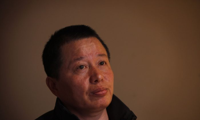 Gao Zhisheng, a human rights lawyer, meets the media after being detained by Chinese security agents for 13 months at a teahouse in Beijing, China, on April 7, 2010. (AP Photo/Gemunu Amarasinghe)