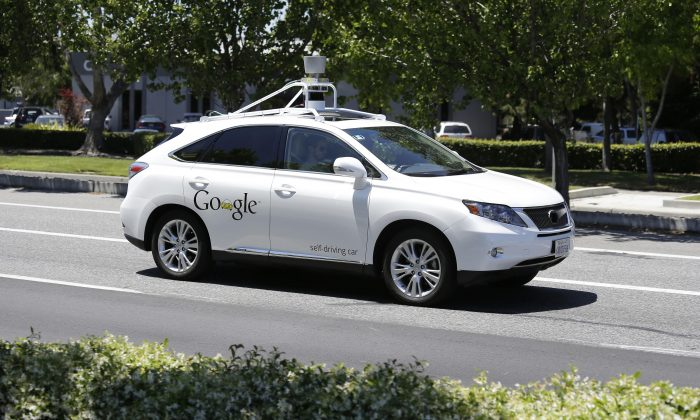 A Google self-driving car goes on a test drive near the Computer History Museum in Mountain View, California on May 13, 2014. (AP Photo/Eric Risberg, File)