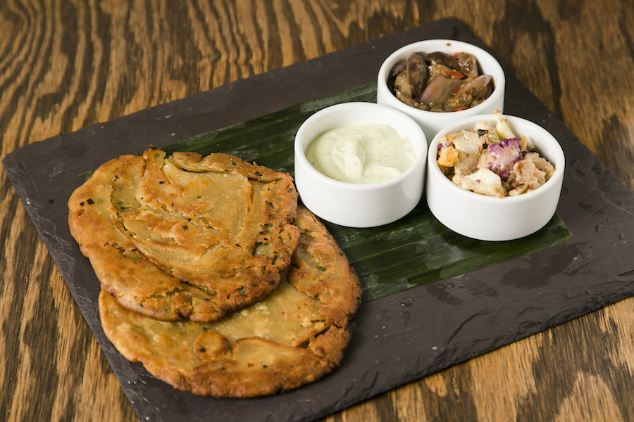 Huynh's Khan Scallion Pancake with miso eggplant, caramelized cauliflower, and silken olive oil. (Samira Bouaou/Epoch Times)