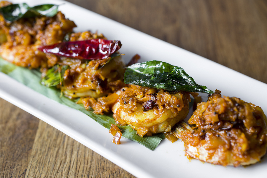 The addictive Shrimp Kokum, shrimp marinated in kokum juice, topped with fried shal lots and ginger. (Samira Bouaou/Epoch Times)