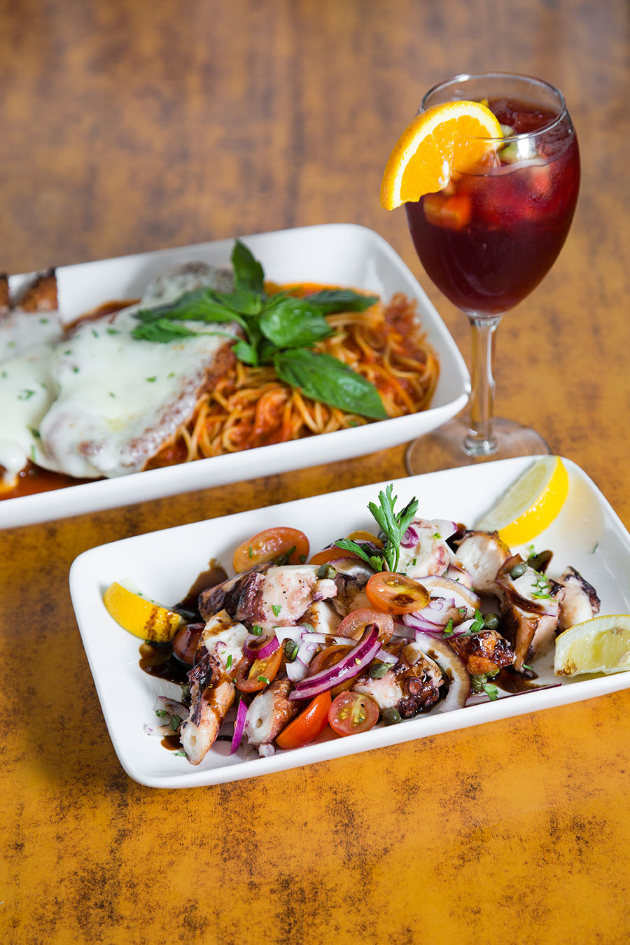 Chicken Parmigiano (top) and Octopus Cocktail (bottom). (Samira Bouaou/Epoch Times)