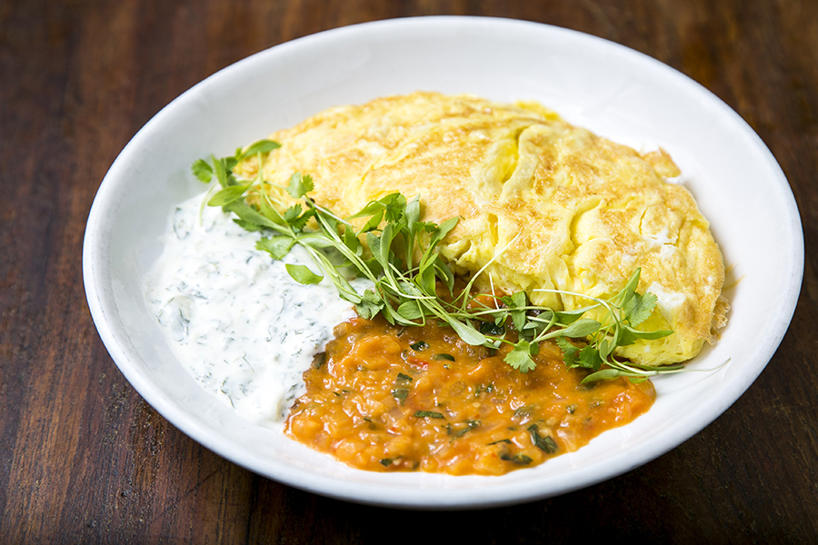 Gruyere cheese omelet with spicy tomato sauce and cilantro cream. (Samira Bouaou/Epoch Times)