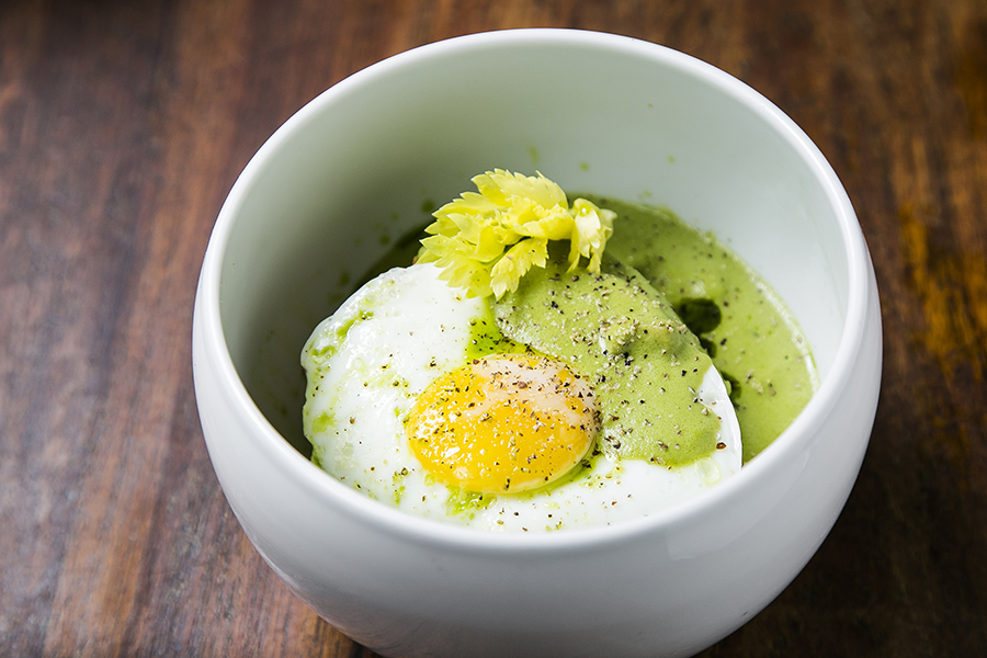 """We found this dish next to the word """"comfort"""" in the dictionary. A biscuit, fried egg, and green curry sausage gravy. (Samira Bouaou/Epoch Times)"""
