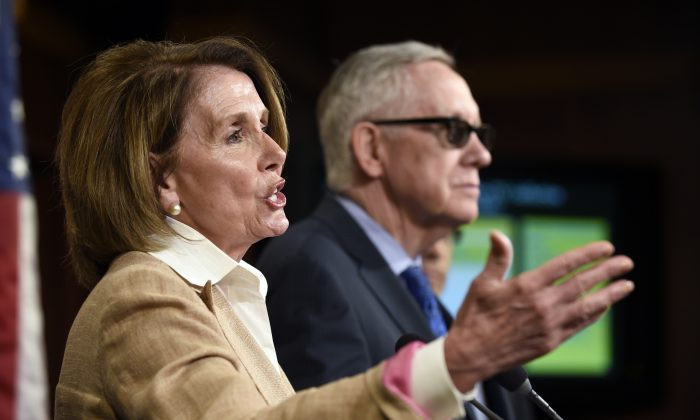 House Minority Leader Nancy Pelosi of Calif., left, accompanied by Senate Minority Leader Harry Reid of Nev. speaks during a news conference on Capitol Hill in Washington, Thursday, June 25, 2015, where they discussed various topics including trade and the Supreme Court's health care ruling. (AP Photo/Susan Walsh)