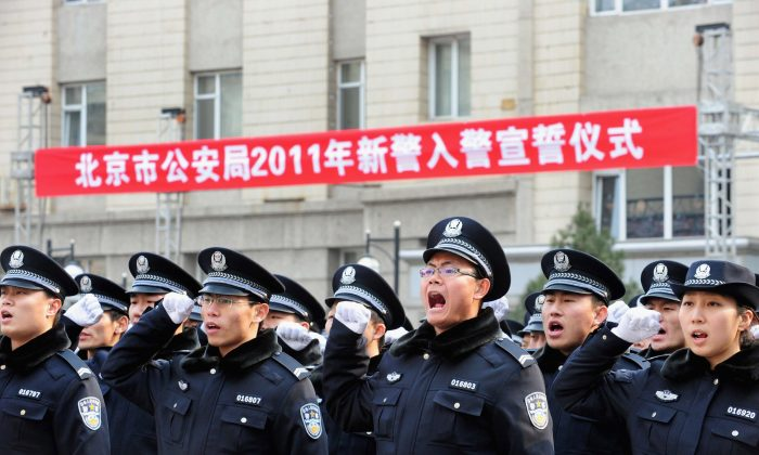 Police recruits shout vows as they join the Beijing Public Security Bureau on February 18, 2011. (ChinaFotoPress/Getty Images)