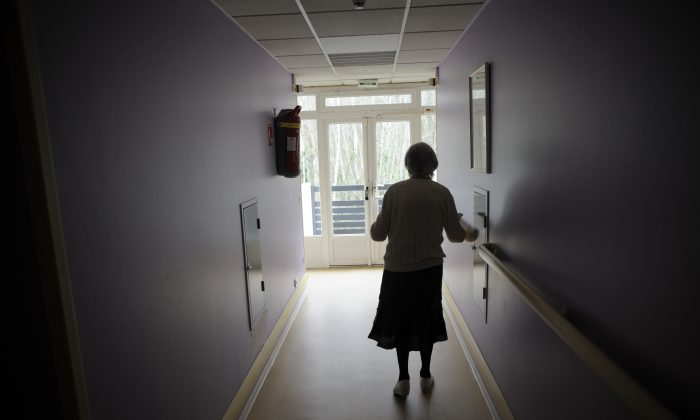 A woman, suffering from Alzheimer's disease, walks in a corridor in a retirement house in Angervilliers, eastern France, on March 18, 2011. (Sebastien Bozon/AFP/Getty Images)