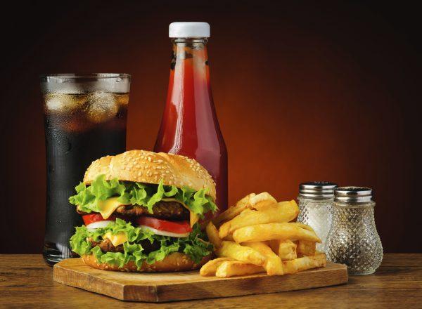 still life with fast food hamburger menu, french fries, soft drink and ketchup