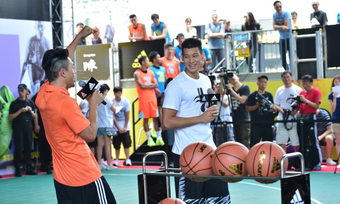 Jeremy Lin talks to fans at the opening of Adidas Sports Base 2015, at the Harbour-front exhibition space, Central Hong Kong on Sunday June 28. (Bill Cox/Epoch Times)